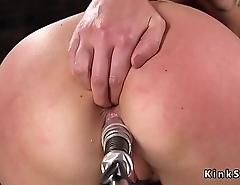 Brunette in stockings shafting machine