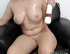 Horny busty brunette uses a dildo with a vibrator