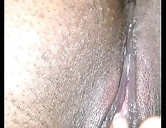 Wet pierced ebony pussy