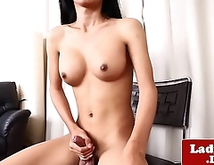 Real ladyboy tugging and stroking her cock