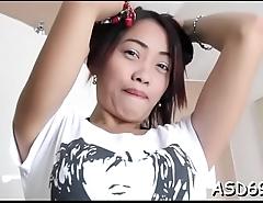 Thai gal masturbates and sucks