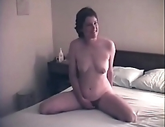 My wife posing nude overhead the bed